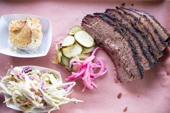 A plate of brisket with jalapeño slaw and smoked scallop potatoes at Interstellar BBQ  in 2019.
