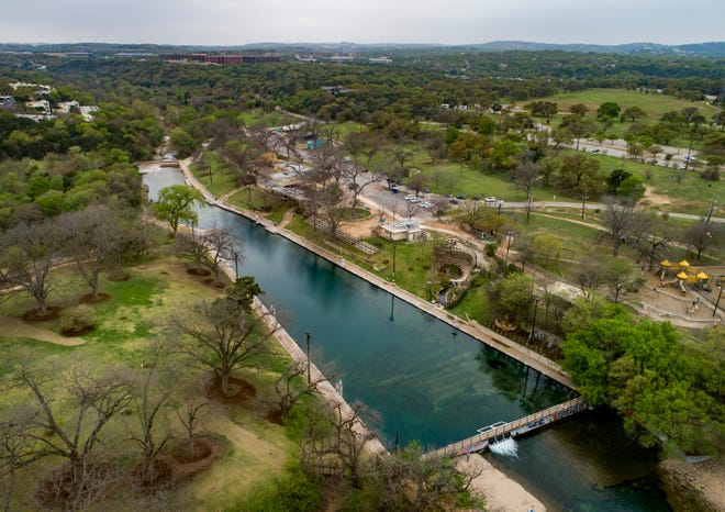 Barton Springs Pool is operated under an agreement with the federal government to protect it as an endangered species habitat. A GOP bill could jeopardize city operations of the pool, city officials say.