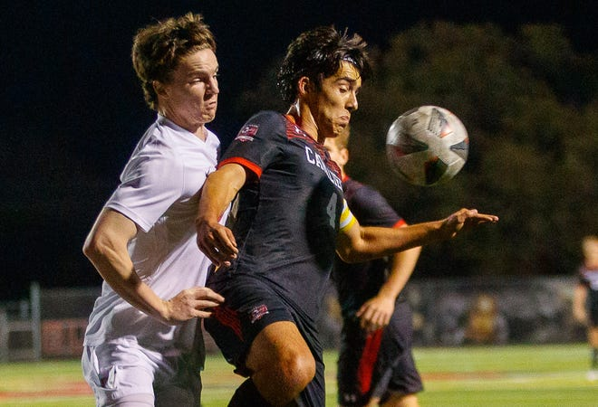 Lake Travis Cavaliers' Bernardo Vargas, right, chest-traps the ball as Westlake's Eddie Scott provides the pressure in a match earlier this month. The Cavs end the regular season as the No. 1 Class 6A team in both the Statesman's area poll and MaxPreps' state poll.