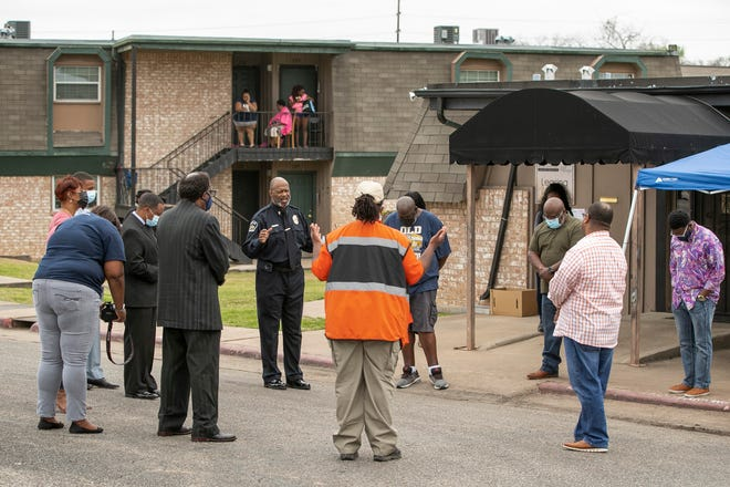 Faith leaders and others gather at Mount Carmel Village Apartments on Wednesday March 24, 2021, to pray for residents who have been without gas for more than a month.
