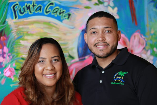 (L-R) Punta Cana Latin Grill co-owners and Steising and Frank Cambero pose in the upstairs didning area of their Athens, Ga. restaurant on Tuesday, March 23, 2021.