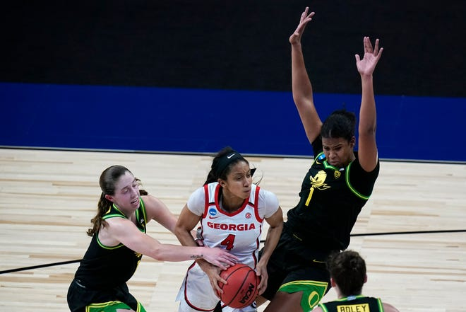 Georgia guard Mikayla Coombs (4) drives to the basket between Oregon guard Taylor Mikesell, left, and forward Nyara Sabally, right, during the first half of a college basketball game in the second round of the women's NCAA tournament at the Alamodome in San Antonio, Wednesday, March 24, 2021. (AP Photo/Eric Gay)
