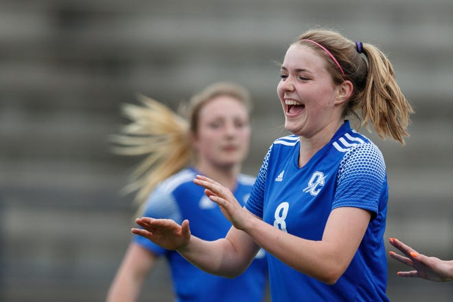 Oconee County's Kylie Wilson (8) celebrates scoring during a game against Apalachee on Tuesday, March 23, 2021 at Oconee County High School in Watkinsville, Georgia. Oconee County defeated Apalachee 7-1. (Julian Alexander for the Athens Banner-Herald)
