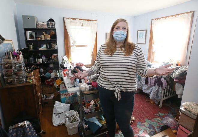 Ali Miller, 30, stands in her childhood room as she talks about moving home from New York City in January 2020 for a theater job at Playhouse Square in Cleveland.