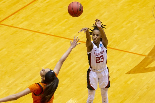 Stanford guard Kiana Williams scores over Oklahoma State guard Neferatali Notoa during the Cardinal's 73-62 win in the second round of the women's NCAA Tournament at the UTSA Convocation Center in San Antonio on Tuesday. In her return to her hometown, Williams scored 12 points in front of approximately 50 family members and friends.