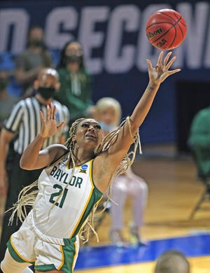 Baylor guard DiJonai Carrington shoots during the Bears' 90-48 win over Virginia Tech in the second round of the women's NCAA Tournament at the Greehey Arena in San Antonio on Tuesday. Carrington had 21 points and eight rebounds in the victory.