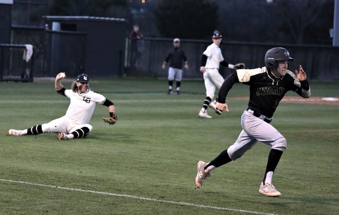 Lone Grove's Jaetyn Cameron, left, makes a throw to first base to throw out Marietta's Jonathan Lohmeyer. Cameron and the Longhorns cruised to a 21-2 decision for their 15th straight victory.