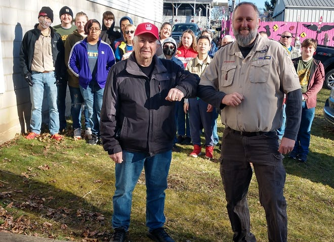 Scoutmaster Eli Lepley, front right, does an elbow bump with Gene Heller, president of Helping Hand in Loudonville, after the Boy Scouts collected 150 bags and boxes of food at their food drive Saturday, March 21. Posted behind them are members of Boy Scout Troop 537 and adult volunteers who gathered the food. Helping Hands distributed food and other services to people in need in the Loudonville-Perrysville area.