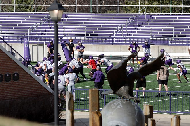 Members of the Ashland University football team go through a drill during practice March 24 at Jack Miller Stadium/Martinelli Field.