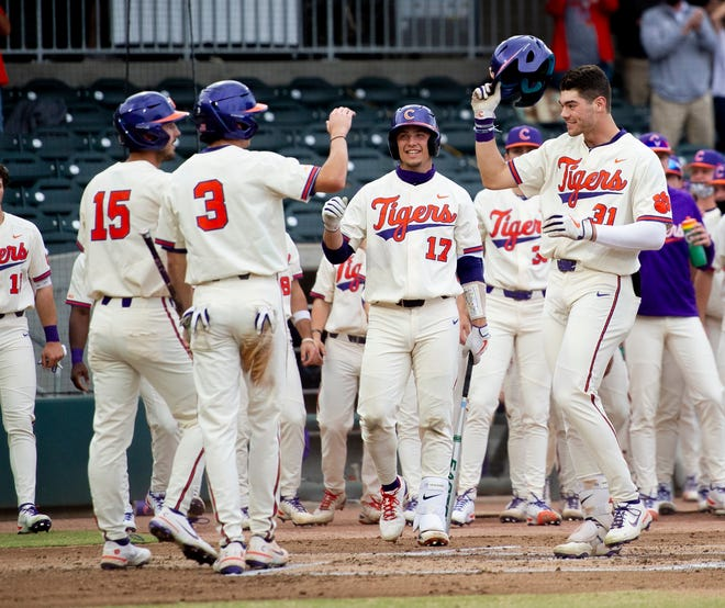 Caden Grice, right, of the Clemson Tigers celebrates a 3 run homer at the college baseball game between Clemson and Georgia Southern at SRP Park on March 23, 2021 in North Augusta, SC. [MIKE ADAMS FOR THE AUGUSTA CHRONICLE]