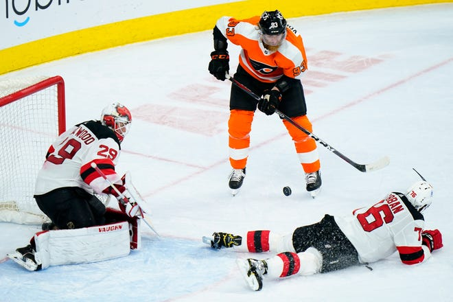 Philadelphia Flyers' Jakub Voracek (93) tries to get a shot past New Jersey Devils' P.K. Subban (76) and Mackenzie Blackwood (29) during the third period of an NHL hockey game, Tuesday, March 23, 2021, in Philadelphia. (AP Photo/Matt Slocum)