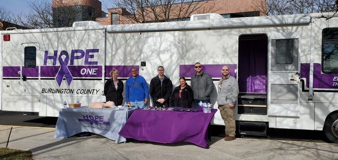 Burlington County Sheriff Anthony Basantis (center) stands with staff from the Hope One unit. The team regularly goes into county communities to help link residents with recovery specialists and treatment facilities. The unit also trains people on how to administer overdose antidote, known as Narcan.