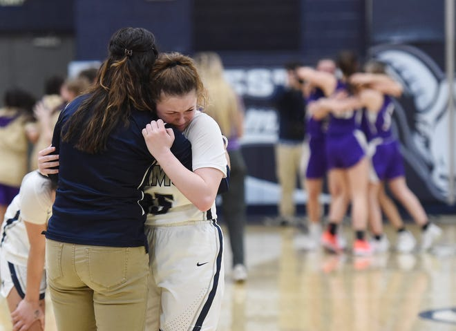 Rochester's Kallista Seybert is consoled after the Rams' PIAA Class 1A semifinal loss to Bishop Guilfoyle Tuesday night at Rochester Area High School.
