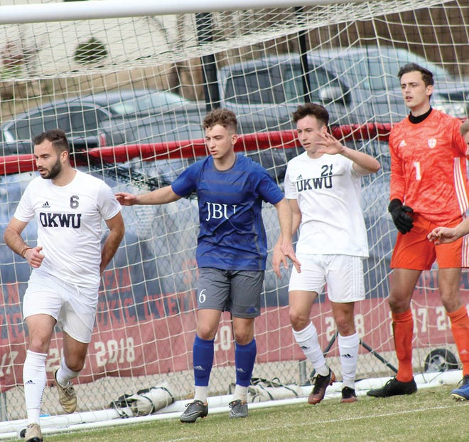 Oklahoma Wesleyan University soccer players Alexandre Lebrisse, No. 6, and Pol Mur, No. 21, set up for a corner kick during home action earlier in March.