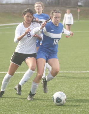 Boonville sophomore Leah Ziegelbein battles for the ball against Hickman's Isabella Laird in the first half Tuesday night at the Boonville City Soccer Field. The Kewpies beat Boonville 8-0.