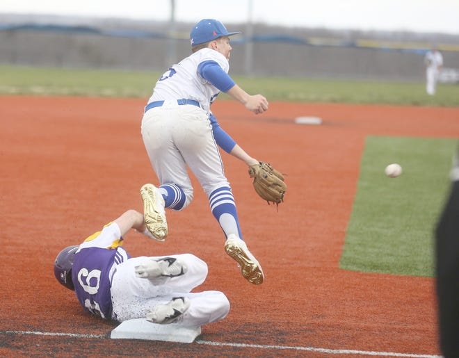 Boonville C-team third baseman Isaiah Hauptmann tries to make a play on the ball while leaping over a Hickman player in the first game of a doubleheader Tuesday night at the high school ballfield. The Kewpies picked up the sweep against Boonville, winning by the scores of 10-0 and 10-7.