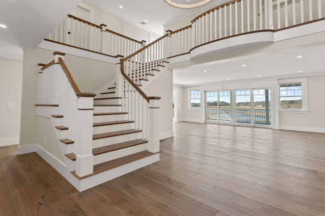 This central staircase is easy to imagine being the focal point for this Vine Avenue home with vast and stunning views. [COURTESY MIKE KARRAS]
