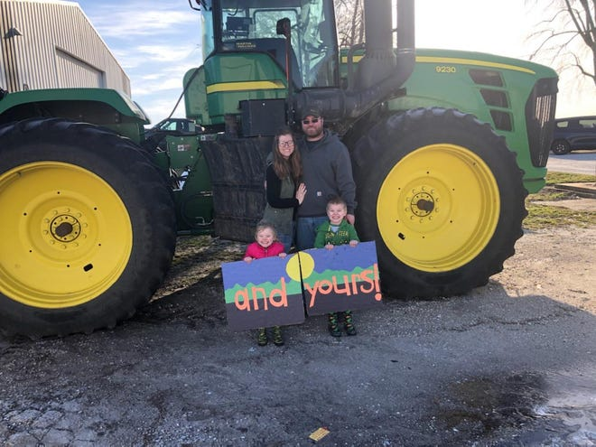 Pictured are Natalie and Seth Vohland with their children celebrating Agriculture Week.