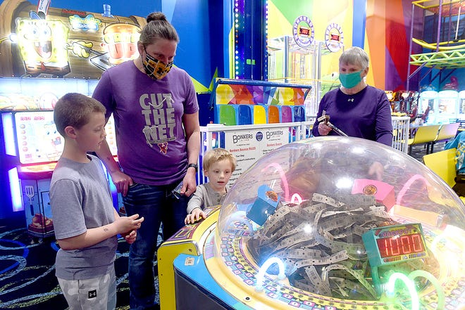 Nancy Laurenti, second from left, of Marshall, explores Bonkers arcade and eatery at 3812 Buttonwood Drive on Wednesday with her son Brayden, 8, nephew Cooper Dehn, 4, and the boys' grandmother Patsy Dehn.
