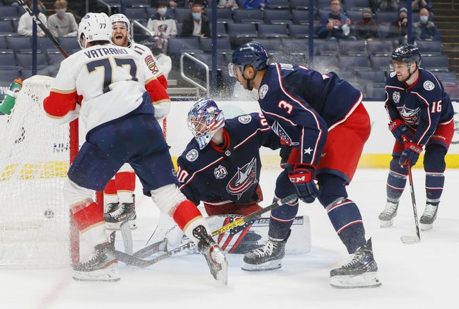 Blue Jackets goaltender Elvis Merzlikins (90) and defenseman Seth Jones (3) rue the point that got away when Florida's Frank Vatrano scored in overtime to give the Panthers a 5-4 win on March 11.