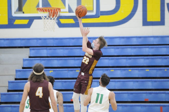 Morenci's Breckin Alcock goes up for a layup during Tuesday's district game against Monroe St. Mary Catholic Central.