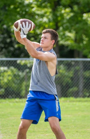 Southwestern Randolph's Bryson Reid makes a catch during a summer workout. Reid and the Cougars fell 37-14 to Southern Alamance on Tuesday. PJ WARD-BROWN FOR THE COURIER-TRIBUNE]