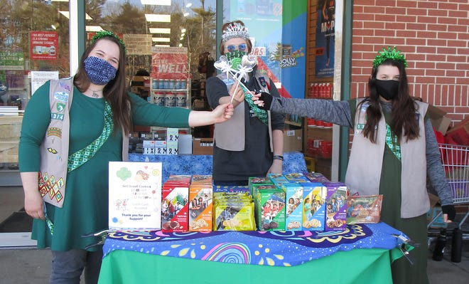 Alanna Bonneau, 15, left; Sophia Curtis, 15, center; and Jasmine Tweedie, 13, all of Dover Girl Scout Troop 13946, have big plans for the use of their Girl Scout Cookie proceeds, having sold 5,156 packages of cookies between the three of them