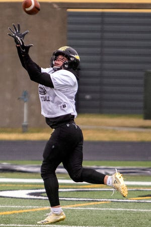 Galesburg High School junior Dre Egipciaco hauls in a pass during football practice on Tuesday, March 23, 2021 at Van Dyke Field.