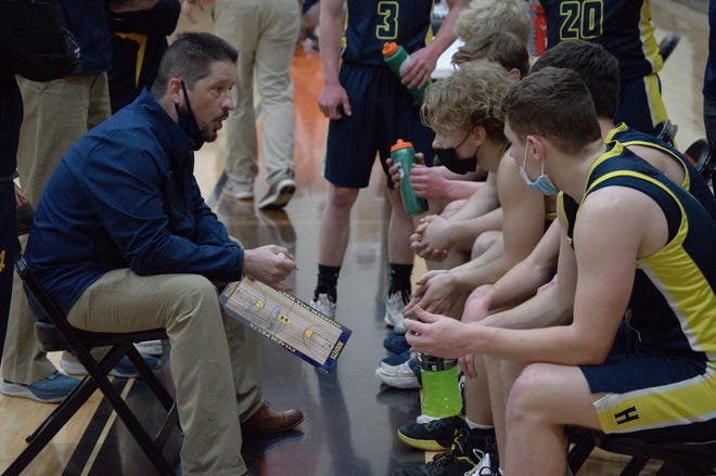 Hillsdale Head Coach Brad Felix; on the sidelines coaching up his players during a timeout this past season.