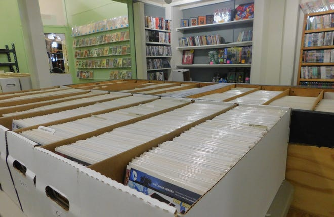 Long boxes filled with comics dating as far back to the 1960s sit on a table in Wolverine Comics.