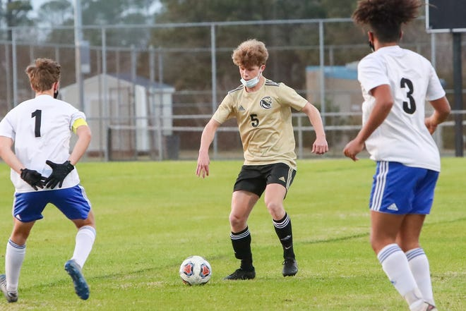 Croatan's Eli Simonette tries to get the ball defenders during the Cougars' 2-0 win over Richlands on Tuesday in the NCHSAA 2-A East Regional final.