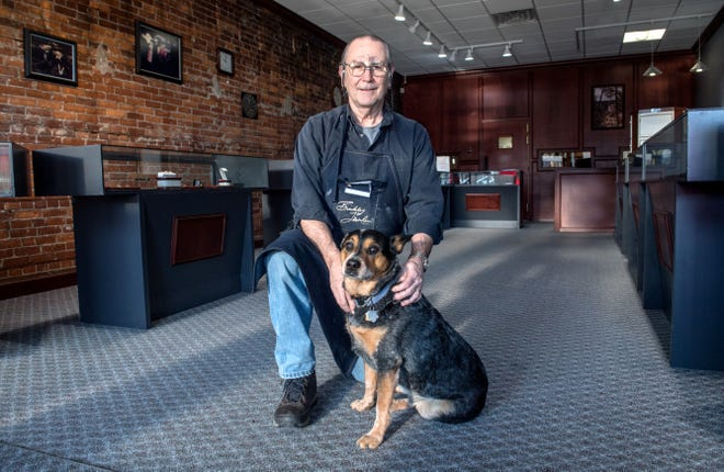 Bruce Binkley poses with his dog, Echo, a 7-year-old blue heeler, at Binkley Jewelers, 105 S. Main St., Morton. Binkley has run his jewelry store since 1982 and is retiring and closing the store March 31. He turns 66 on April 1.