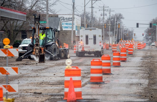 A worker breaks up pavement Tuesday, March 23, 2021 as part of a massive upgrade project to Western Avenue from Lincoln all way to Malone in South Peoria. That entire section of Western is closed except for streets that intersect.