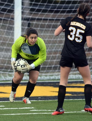 Newton senior Aketzali Solorio-Jimenez makes one of her six saves in the first half of play against Buhler in the season opener at Fischer Field. The game was the first high school spring sport contest in the area since 2019.