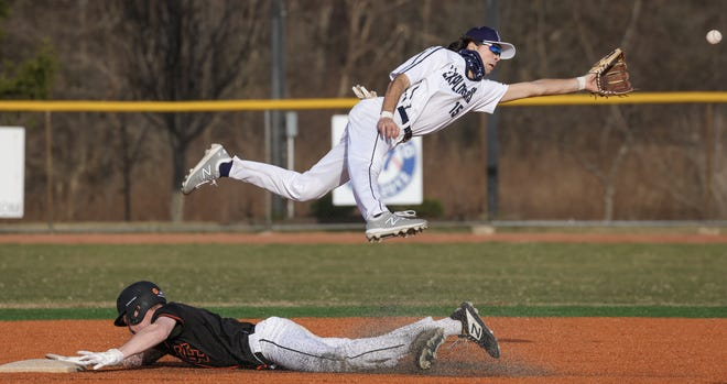 Hudson's Wyatt Prado (15) attempts to field a ball at second base in a scrimmage against Chagrin Falls earlier this month.