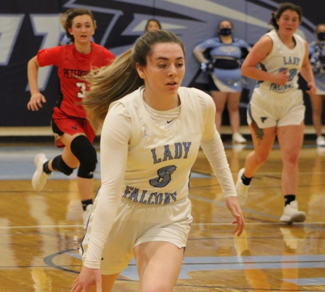 Frankfort's Izzy Layton makes her way to the basket against Petersburg on Tuesday. Layton pulled off a double-double performance and finished second on the team in scoring with 12 points.