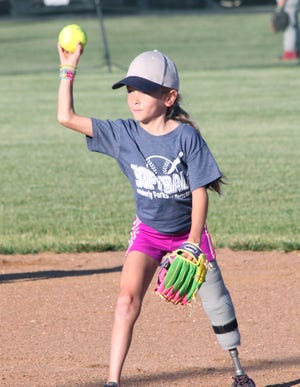 A young softball player ushers a throw during a Moberly Parks and Recreation Department age 8U Coach Pitch Softball League game played at the Howard Hils Athletic Complex.
