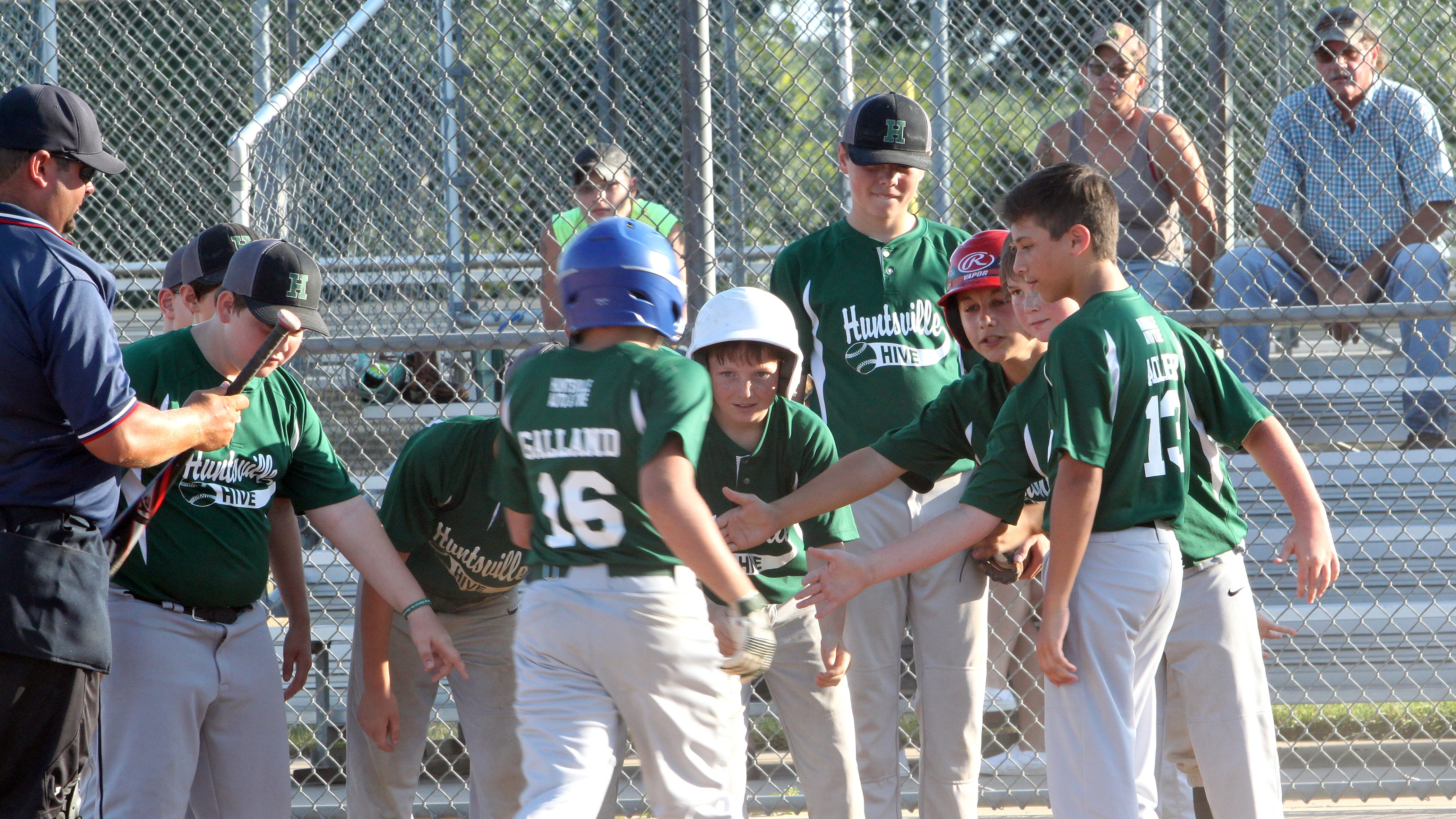 Nathan Galland of the Moberly Midget League's age 12U Huntsville Hive is greeted at home plate  after belting a 2-run homer during his team's  9-8 loss to Centralia Thunder in a game played July 13, 2020 at the Howard Hils Athletic Complex.