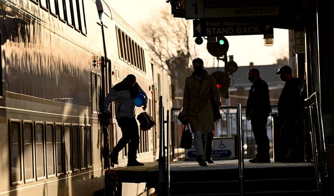 Passengers step off an evening commuter train Tuesday in downtown Framingham. The MBTA has agreed to fund pre-pandemic service levels.