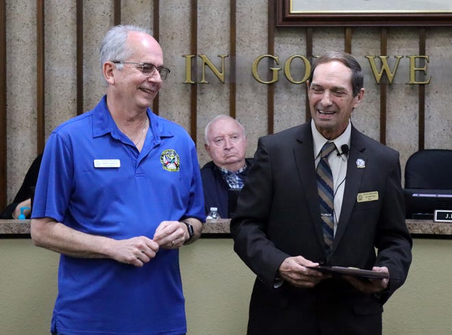 Crestview City Councilman Harry LeBoeuf shares a laugh with Mayor JB Whitten as they reminisce about their service years at MacDill Air Force Base during the mayor's presentation of a certificate of appreciation upon the councilman's departure.