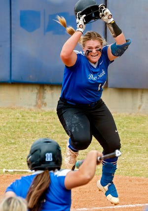 Deer Creek's Terin Ritz (14) celebrates after scoring a run against Mustang during a state quarterfinal last October in fastpitch softball at Hall of Fame Stadium in Oklahoma City.