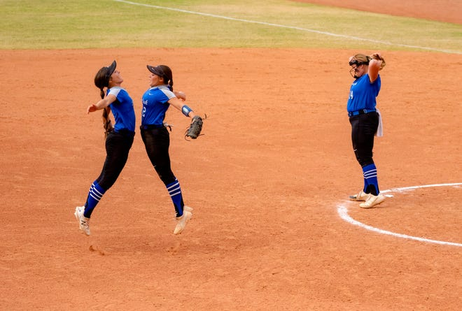 Deer Creek's Taylor Smith (2) and Peyton Norvelle (9) go through their pre-inning ritual in front of pitcher Terin Ritz (14) as they take on Mustang in the state fastpitch softball quarterfinals on Oct. 15 at USA Hall of Fame Stadium in Oklahoma City.