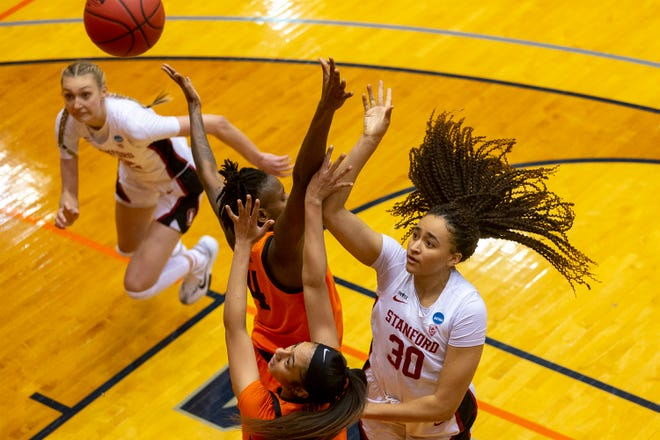 Stanford guard Haley Jones (30) shoots over Oklahoma State forward Natasha Mack (4) and guard Neferatali Notoa during the second half of a 73-62 win in the NCAA Tournament on Tuesday at the UTSA Convocation Center in San Antonio.