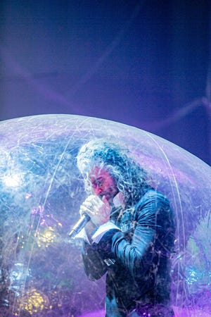 """The Flaming Lips' Wayne Coyne performs during """"the World's First Space Bubble Concerts"""" Jan. 22-23 at The Criterion in Bricktown. All the band members and audience members were in plastic orbs for the shows, with each Space Bubble accommodating up to three people."""