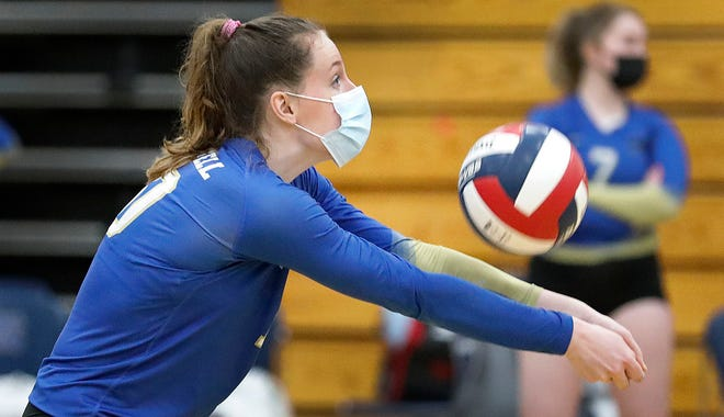 Norwell'sJulie Neumann sets up the ball for a spike. Norwell hosted Abington in volleyball on Wednesday, March 24, 2021.