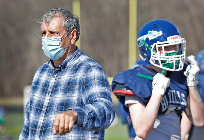 Blue Hills football coach Ed Catabia, shown here at practice on March 24, 2021, will coach his final game for the Warriors on Thursday, April 29, 2021. Catabia has been head coach for 13 seasons and has been with the program for 42 years.
