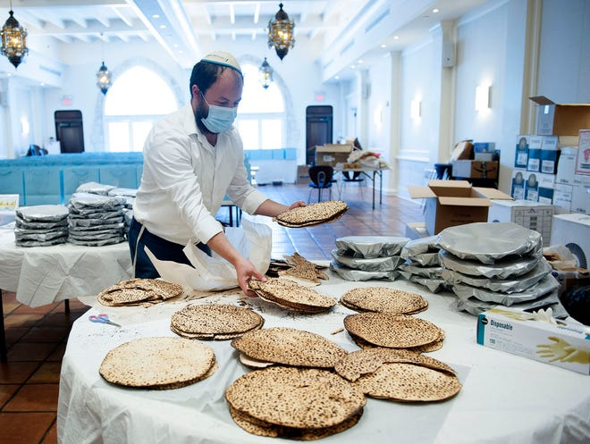 Rabbi Yosef Rice packs homemade matzo into 425 Passover packages at the Palm Beach Synagogue on Tuesday. The synagogue will mark the Jewish holiday of Passover with a pair of outdoor Seders on Saturday and Sunday.