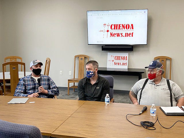 Challenger Joey Bell, left, speaks at a candidate forum at Chenoa Public Library Tuesday. Listening are incumbents Kyle Buchanan, middle, and Dwayne Price.
