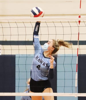 Prairie Central's Alyssa Stein delivers an attack for the Hawks against St. Thomas More Tuesday. Stein led PC with 5 kills in a two-set loss.