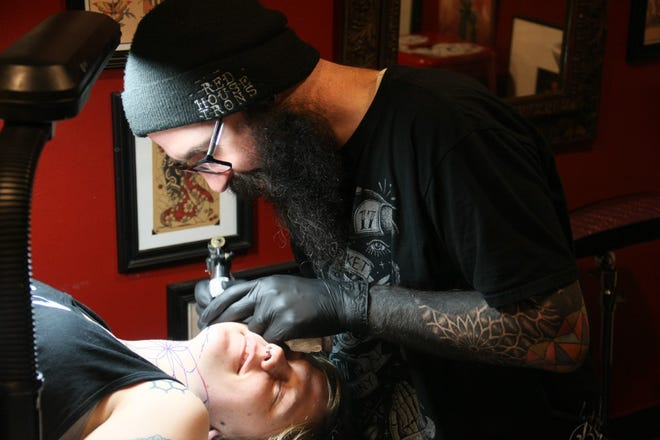 Tattoo artist Thomas Gustainis, owner of Red House Irons in Fitchburg, Massachusetts, wants to open a shop in downtown Exeter but can't due to a town ban on tattooing.
